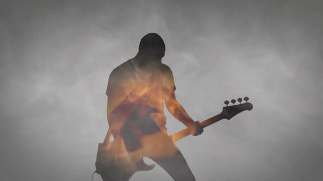 Rising Sun videoclip screenshot, bass on fire